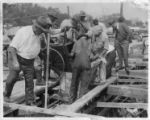 Pouring concrete to build the Bayshore Seawall, Tampa, Florida, March 11, 1936.