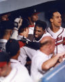 Atlanta Braves team members congratulate Deion Sanders after hitting a homerun, 1992