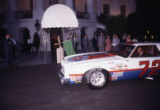 First Lady Rosalynn Carter flags in race car drivers at the White House, 1978