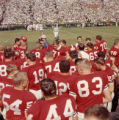 Georgia Bulldogs' players gather on the sidelines before a game, 1965