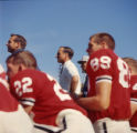 Coach Vince Dooley and Georgia Bulldogs' watch the game from the sidelines, 1965