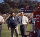 Coach Vince Dooley and assistant Bill Dooley during a game, 1965