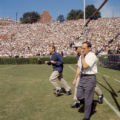 Coach Vince Dooley, assistant coach Bill Dooley and staff run out onto Sanford Stadium's field,...
