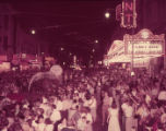 Crowds gather at night to watch the Fulton Centennial Parade, 1954