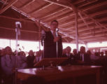 Secretary of Agriculture Orville Freeman delivers a speech to a crowd of farmers, 1961