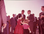 Senator John F. Kennedy being presented flowers after arriving in Georgia, 1960