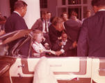 Senator John F. Kennedy meets with a disabled child at the Little White House, 1960