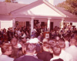 Crowds gather to hear presidential candidate John F. Kennedy speak at the Little White House, 1960