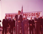 Presidential candidate John F. Kennedy delivering a campaign speech at the LaGrange airport, 1960