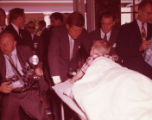 Senator John F. Kennedy meets with a disabled boy in Warm Springs, 1960