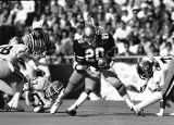 Georgia Tech's Robert Lavette hits the hole against the Georgia Bulldogs, circa 1980s