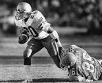 North Carolina's Noel McEachern tackles Tech's Robert Levette for a loss, 1984