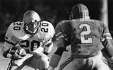 Georgia Tech's Robert Lavettes jukes the Tar Heels' Barry James, 1984