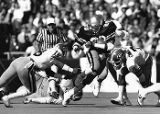 Georgia Tech's Robert Lavette finds an opening against the Georgia Bulldogs, circa 1980s