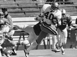 Georgia Techs' Eddie Lee Ivery breaks through the Miami Hurricanes defensive line, 1978