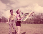 Young teenagers race model airplanes, 1951
