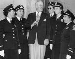 Atlanta Police Chief Jenkins with five policewomen at headquarters, 1958