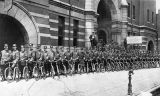 Police officers line up with their bicycles in front of the Atlanta Police Headquarters, 1906
