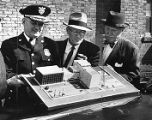 Atlanta Police Chief Herbert Jenkins with an architectural model of the new police headquarters,...