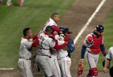 The Indians celebrate after winning in the 11th inning, World Series Game Three, 1995