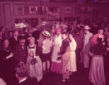 Costumed crowds bring in the New Year at the annual Nine O'Clocks ball, 1952