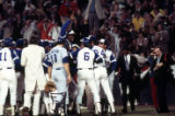 Hank Aaron being congratulated at home plate after breaking the home run record, 1974