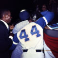 Hank Aaron's mother greets him on the field after breaking the home run record, 1974