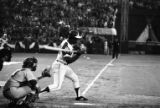 Hank Aaron mid-swing during his 715th home run, 1974