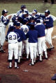 Atlanta Brave Hank Aaron is met at home plate by his teammates after hitting his record breaking...