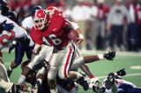Georgia Bulldogs' Kirby Smart returning a kick against Virginia in the Peach Bowl, 1995