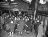 Integrated crowds try to see the Freedom Train exhibit after it closed, 1948