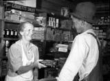 Customer at the small Whitener general store, 1950