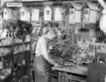 Rows of wooden toys line a toymaker's studio, 1946