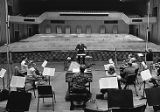Conductor Robert Shaw directs a group of musicians during a recording session, 1983