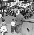 Supporters of Randolph Thrower listen to a campaign speech in Hurt Park, 1956