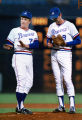 Braves' manager Chuck Tanner meets with pitcher Craig McMurtry during the 11th inning against the...