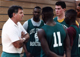 Life College coach Roger Kaiser with his basketball team during practice, 1992