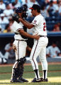 Braves' catcher Greg Olson gives pitcher John Smoltz a pep talk, 1990