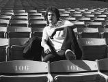 Braves' Buzz Capra sitting in the Fulton County Stadium seats, 1976