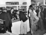 Customers line up at the newly opened liquor store after the end of prohibition, 1938