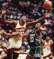 Hawks Cliff Levingston battles for a loose ball with the Bucks' Jeff Grayer, 1990