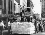 Southeastern Fair parade float tangled on street car wires, 1950s