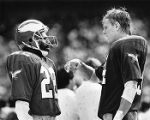 Philadelphia Eagles' players Terry Hoage and Bernard Wilson strategizing before a play, 1986