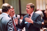 Georgia State legislator Johnny Isakson speaking with other member of the Georgia House of...