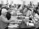 Players line the table at the SCLO Bingo Parlor, 1978