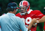 Coach Marion Campbell with defensive end Tim Green during the Atlanta Falcons practice, 1986