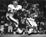 Atlanta Falcons' Bob Lee escaping the rush, 1974