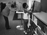 Patrons using an automated card catalog at the new Atlanta Central Library, 1980
