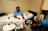Elderly woman in public housing, confined to downstairs apartment without a bathroom, Atlanta,...