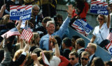 Supporters of presidential candidate Bill Clinton gather to hear him speak during a campaign stop,...